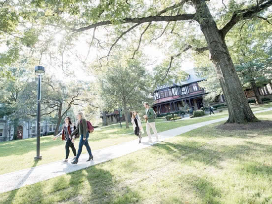 Students walking along a path on campus