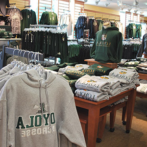 Loyola sweatshirts and t-shirts hanging in the 葡京app 书店